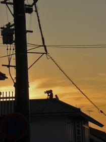 夕焼けのカメラマン